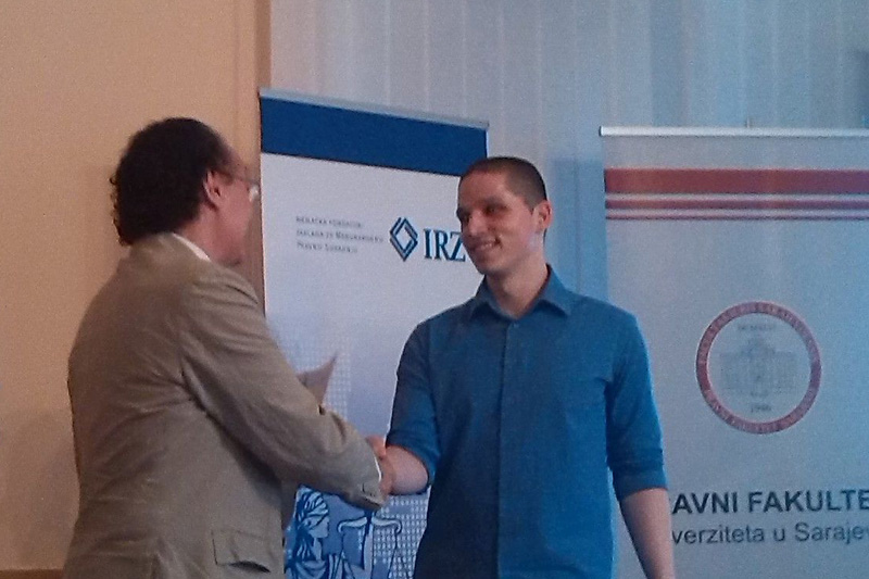 Graduate Harun Nović receiving his diploma