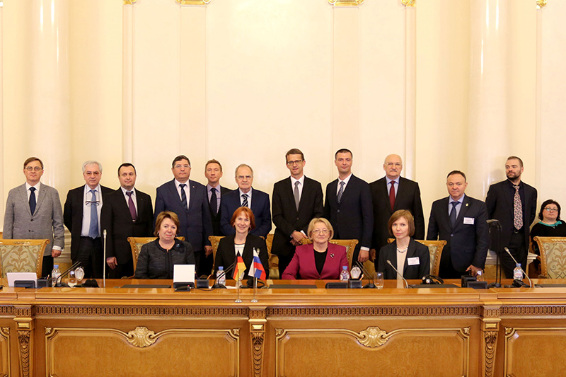 The Chairman of the Constitutional Court of the Russian Federation, Valery D. Zorkin (middle, at the back) welcomes the speakers to the historic court building
