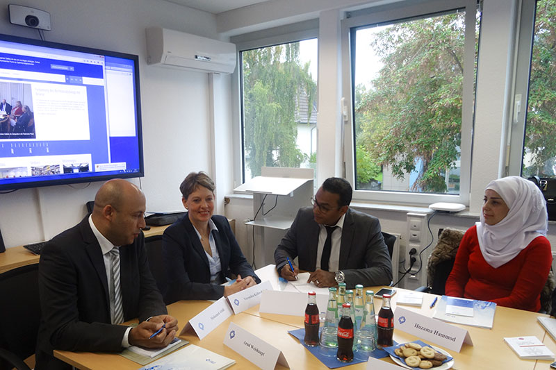 Veronika Keller-Engels (at the centre), IRZ General Director, and Mohamed Montasser Abidi (left), Head of Section for Northern Africa / Middle East, welcoming the particpants of the seminar