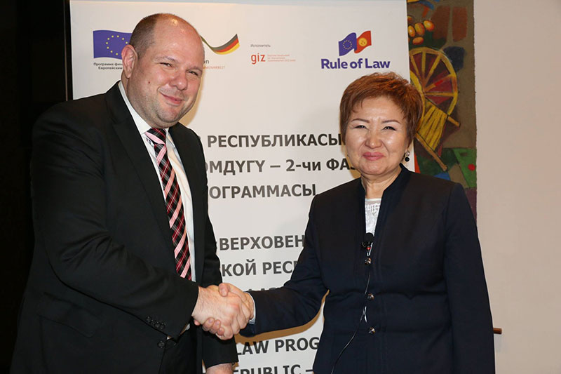 Christoph Kopecky, IRZ long-term expert on the EU's Rule of Law Program in Kyrgyzstan, and Gulbara Kalieva, Chair of the Supreme Court
