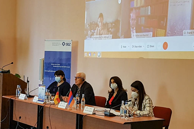 Dean of the law faculty at Yerevan State University, Prof. Gagik Ghazinyan (centre), during his lecture. Vice Dean Prof. Anna Margaryan (on the left), lecturer Sose Barseghyan (on the right), on her left, Nelly Tumasyan, IRZ project coordinator in Armenia